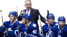 Toronto Maple Leafs head coach Randy Carlyle, back centre, looks over his players while playing against the St. Louis Blues during second period NHL action in Toronto on Tuesday, March 25, 2014. (Nathan Denette/THE CANADIAN PRESS)