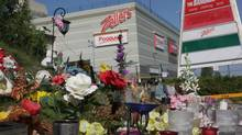 A makeshift memorial sits outside the Algo Centre Mall in Elliot Lake, Ont., on Tuesday, Aug. 14, 2012. Part of the mall's rooftop garage collapsed June 23, killing two people. (Colin Perkel/THE CANADIAN PRESS)