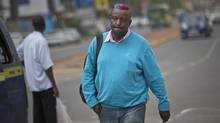 Prize-winning Kenyan author Binyavanga Wainaina walks down a street in Nairobi, Kenya Wednesday, Jan. 22, 2014. Wainaina, one of Africa's leading literary figures, spoke to The Associated Press on Wednesday to explain his decision to publicly declare his homosexuality in an online essay last weekend, in light of a wave of new legislation further criminalizing homosexuality in Nigeria and Uganda. (AP Photo/Ben Curtis) (Ben Curtis/AP)