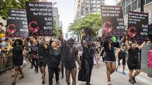 People from the Blacks Lives Matter movement march during the Pride parade in Toronto, Sunday, June 25, 2017. (Mark Blinch/THE CANADIAN PRESS)