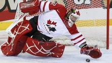 Charline Labonte from Canada clears a puck during the IIHF World Women Championship Group B hockey match between Canada and Switzerland, Saturday, April 16, 2011 in Winterthur, Switzerland. (Alessandro Della Bella/AP)