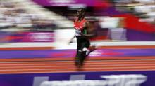 Kenya's David Lekuta Rudisha competes in his men's 800m round 1 heat during the London 2012 Olympic Games at the Olympic Stadium on Monday. (KAI PFAFFENBACH/REUTERS)