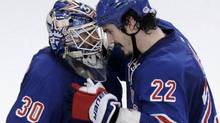 New York Rangers goalie Henrik Lundqvist (L) is congratulated by teammate Brian Boyle after the Rangers defeated the New Jersey Devils in Game 1 of the NHL Eastern Conference Finals hockey playoffs at Madison Square Garden in New York, May 14, 2012. REUTERS/Ray Stubblebine (RAY STUBBLEBINE)