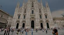 People walk on Duomo Square in Milan (GIUSEPPE CACACE)