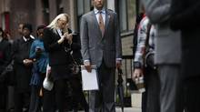 Job seekers stand in line to meet with prospective employers at a career fair in New York City in this file photo. (MIKE SEGAR/REUTERS)
