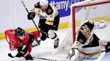 Ottawa Senators right winger Bobby Ryan attempts a wrap-around on Boston Bruins goalie Tuukka Rask as Boston Bruins defenceman Colin Miller looks on during Game 1 on Wednesday. (Sean Kilpatrick/THE CANADIAN PRESS)