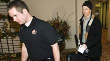 Forward Cody Eakin, right, from the Swift Current Broncos, is escorted by team media relations assistant Paul Krotz after being cut from the Canadian national junior team selection camp for the World Junior Ice Hockey Championships Wednesday, December 16, 2009, in Regina. (Ryan Remiorz)