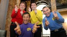 In this June 28, 2006 file photo, Australian children's entertainers The Wiggles, Murray Cook (Red Wiggle), Greg Page (Yellow Wiggle), Jeff Fatt (Purple Wiggle), and Anthony Field (Blue Wiggle) make a special appearance at the Australian High Commission in London at the start of their UK tour. (Christopher Pledger / AP)