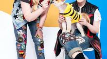 Fashion bloggers Caillianne, left, and Samantha Beckerman with their dog Cubby. (Hudson Hayden for The Globe and Mail)