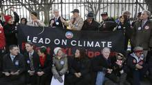 Sierra Club Executive Director Michael Brune (top row, fourth from left) and activists opposed to the Keystone XL pipeline project tie themselves to the White House fence during a protest on Feb. 13, 2013. The arrest of the Sierra Club's top U.S. leaders marked the first time in its 120-year history that it had condoned civil disobedience. (JONATHAN ERNST/REUTERS)