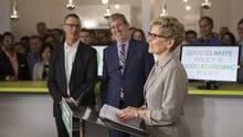 Ontario Premier Kathleen Wynne addresses the media during an announcement outling a cap-and-trade deal with Quebec aimed at curbing green house emissions, in Toronto on April 13 2015. (Chris Young/THE CANADIAN PRESS)