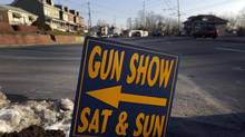 A sign is posted for an upcoming gun show, Friday, Jan. 4, 2013, in Leesport, Pa. Gun advocates aren't backing down from their insistence on the right to keep and bear arms. But heightened sensitivities and raw nerves since the Newtown, Conn. shooting are softening displays at gun shows and even leading officials and sponsors to cancel the popular exhibitions altogether. (Matt Rourke/AP)