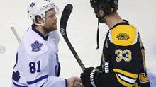 Toronto Maple Leafs' Phil Kessel shakes hands with Boston Bruins' Zdeno Chara after the Bruins defeated the Leafs in overtime in Game 7 of their NHL Eastern Conference quarter-final hockey playoff series in Boston, Massachusetts May 13, 2013. (BRIAN SNYDER/REUTERS)