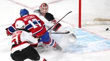 Montreal Canadiens centre Torrey Mitchell (17) scores goal past New Jersey Devils goalie Cory Schneider (35) in front of centre Sergey Kalinin (51) during the second period at Bell Centre in Montreal on Wednesday, Jan. 6, 2016. (Jean-Yves Ahern/USA Today Sports)