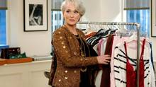 "In The Devil Wears Prada, Meryl Streep, played a powerful editor whose demands exasperate her assistant, played by Anne Hathaway. In this photo provided by Twentieth Century Fox , Meryl Streep's character in ""The Devil Wears Prada"" wears a Bill Blass jacket and dress, and a Roberto Cavalli belt as she flips through racks of designer clothes. (AP Photo/Twentieth Century Fox) (Associated Press)"