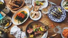 An assortment of dishes including the red snapper, fasolakia, smelts, sardines along with the taramasalata, tzatziki, and kopanisti dips served with pita are seen at Mamakas restaurant in Toronto. (JENNIFER ROBERTS FOR THE GLOBE AND MAIL)