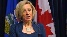 Alberta Premier Rachel Notley speaks at the legislature on April 11, 2016. On Monday, Alberta's NDP government introduced dramatic cuts to the amount of cash individuals can donate to political parties and candidates. (Dean Bennett/The Canadian Press)