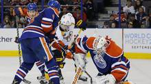 Edmonton Oilers goaltender Laurent Brossoit (1) tries to cover a loose puck in front of Nashville Predators forward Craig Smith (15) during the third period at Rexall Place in Edmonton. (Perry Nelson/USA Today Sports)