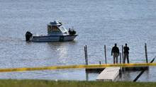 Conservation police search Silver Lake in Highland, Ill., on Thursday, March 16, 2017, after a car with an infant was pulled from the lake earlier in the morning. (Laurie Skrivan/AP)