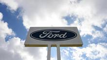 The Ford Motor Co. logo is displayed on signage outside the company's Australia head office in Melbourne, Australia, on May 23, 2013. (Carla Gottgens/Bloomberg)