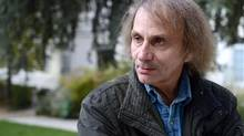 The imagined future and exaggerations in Michel Houellebecq's new novel, Submission, can be interpreted as satire. (MIGUEL MEDINA/AFP/Getty Images)