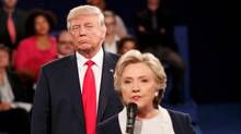 Republican U.S. presidential nominee Donald Trump listens as Democratic nominee Hillary Clinton answers a question from the audience during their presidential town hall debate at Washington University in St. Louis, Missouri, U.S., October 9, 2016. (RICK WILKING/REUTERS)