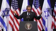 U.S. President Barack Obama gestures during his address to Israeli students at the International Convention Center in Jerusalem on March 21, 2013. Mr. Obama appealed directly on Thursday to the Israeli people to put themselves in the shoes of stateless Palestinians and recognize that Jewish settlement activity in occupied territory hurts prospects for peace. (BAZ RATNER/REUTERS)
