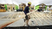 A construction worker works on building new homes in Calgary in this file photo. Statscan released its latest report Wednesday on Canada' economic growth. (TODD KOROL/REUTERS)