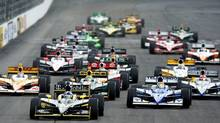 Dario Franchitti leads the pack at the start during the IZOD IndyCar Series MoveThatBlock.com Indy 225 at New Hampshire Motor Speedway on August 14, 2011 in Loudon, New Hampshire. (Donald Miralle/Donald Miralle/Getty Images)