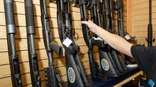 A sales associate takes a gun from a display of shotguns at The Gun Store November 14, 2008 in Las Vegas. (Ethan Miller/2008 Getty Images)