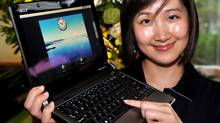 A woman displays a leatest Acer UX-30 notebook during Computex 2009 in Taipei on June 2, 2009. Asia's biggest information technology trade show opened in Taiwan, with the spotlight on low-priced notebook computers and an advanced broadband Internet mobile technology. (SAM YEH)