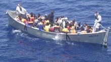 In a photo released by the Italian Navy taken June 29, 2014, a lifeboat from the Italian frigate Grecale carries a group of migrants rescued in the Mediterranean Sea. (ITALIAN NAVY/ASSOCIATED PRESS)