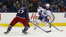 Edmonton Oilers right-wing Nail Yakupov (10) shoots against Columbus Blue Jackets defenceman Dalton Prout (47) during the third period at Nationwide Arena in Columbus, Ohio on Friday, March 4, 2016. Columbus beat Edmonton 6-3. (Russell LaBounty/USA Today Sports)