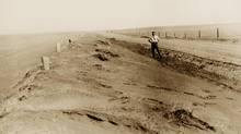 Drought conditions showing drifting soil along a fence between Cadillac and Kincaid, Sask. (Canadian Press)