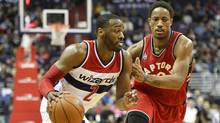 Washington Wizards guard John Wall (2) drives to the basket as Toronto Raptors guard DeMar DeRozan (10) defends during the second half at Verizon Center in Washington, DC on Friday, Jan. 8, 2016. The Toronto Raptors defeated Washington Wizards 97-88. (Tommy Gilligan/USA Today Sports)