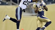 Toronto Argonauts' Brandon Underwood intercepts a pass intended for Winnipeg Blue Bombers' Clarence Denmark during the second half of their CFL football game in Winnipeg, June 26, 2014. (FRED GREENSLADE/REUTERS)