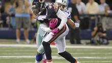 Chicago Bears corner back D.J. Moore (L) is tackled by Dallas Cowboys wide receiver Miles Austin (R) after intercepting a pass in the second half of their NFL football game in Arlington, Texas October 1, 2012. (TIM SHARP/REUTERS)