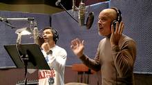 "Dan Hill (right) records a version of his hit ""Sometimes When We Touch"" with boxer Manny Pacquaio. (www.mannysings.com)"