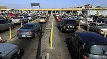Motorists wait in lanes of traffic at the U.S. border crossing in San Ysidro, California September 27, 2011. (MIKE BLAKE/REUTERS/REUTERS/MIKE BLAKE)