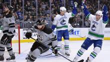 Vancouver Canucks center Henrik Sedin and Bo Horvat celebrate after Sedin scored a shorthanded goal during the first period in Los Angeles, on March 4, 2017. (Jake Roth/USA Today Sports)