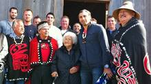 Vancouver Canucks goalie Roberto Luongo, second from right, poses with Haida matriarch Mary Swanson, a lifelong Canucks fan who turned 89 on Sept. 7 and was among those in the First Nations village of Old Massett who welcomed the team during a visit on Tuesday. (David Ebner/The Globe and Mail)