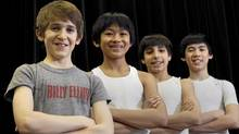 (L to R) Myles Erlick, 12; JP Viernes, 14; Cesar Corrales, 14; and Marcus Pei, 12 at the Elgin Theatre in Toronto. (Deborah Baic/The Globe and Mail)