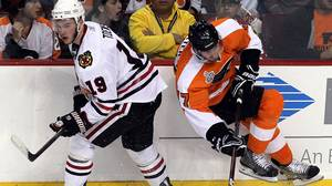 Jonathan Toews #19 of the Chicago Blackhawks checks Jeff Carter #17 of the Philadelphia Flyers in Game Six of the 2010 NHL Stanley Cup Final at the Wachovia Center on June 9, 2010 in Philadelphia, Pennsylvania. (Photo by Jim McIsaac/Getty Images)