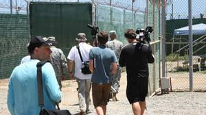 Reporters are escorted on a tour of Camp 4 where Omar Khadr is detained on war-crimes charges on Aug. 11, 2010, at Guantanamo Bay, Cuba.
