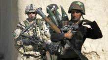 Canadian Cpl. Junot Simard Veillet (L) from the NATO-led coalition patrols with Afghan National Army troops through the Taliban stronghold of Panjwaii town, Kandahar province, southern Afghanistan, October 27, 2007. (Finbarr O'Reilly/Reuters/Finbarr O'Reilly/Reuters)