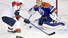 Florida Panthers' Jaromir Jagr scores a goal on Edmonton Oilers' goalie Cam Talbot during first-period NHL action in Edmonton on Sunday, Jan. 10, 2016. (JASON FRANSON/THE CANADIAN PRESS)