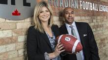 CFL commissioner Jeffrey Orridge and Alyssa Spagnolo pose during the CEO for the Day event at the CFL offices. (Mark Blinch For The Globe and Mail)