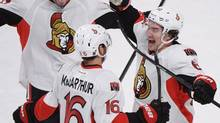 Ottawa Senators' Clarke MacArthur (16) celebrates with teammates Mika Zibanejad, left, and Mark Stone after scoring against the Montreal Canadiens during overtime NHL action in Montreal, Saturday, January 4, 2014. (Graham Hughes/THE CANADIAN PRESS)