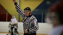 Peter Coleman, the referee-in-chief at True North Hockey makes a call during a game. (DAVE CHAN FOR THE GLOBE AND MAIL)