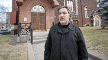 Father George Lagodich stands in front of St Nicholas Russian Cathedral in Outremont, a borough of the city of Montreal, on Thursday, April 5, 2012. (Peter McCabe/THE GLOBE AND MAIL)
